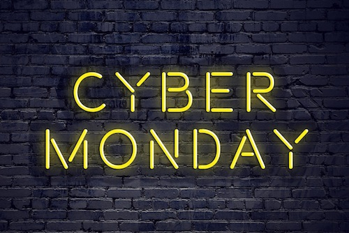 Night view of neon sign with text cyber monday